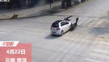 Guy On A Scooter Lands Perfectly On The Roof Of This Car After It Plows Into Him